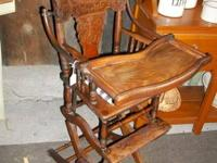 Larkin tiger oak convertible high chair. Becomes rocker