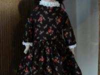 Antique doll purchased 25 years ago for $125. At that