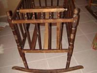 I AM SELLING A LATE VICTORIAN WOODEN CRADLE. IT WAS