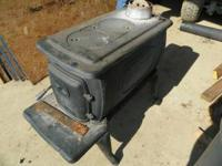Laundry wood stove for sale, $100.00 firm. Call Ray for