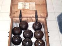 THIS LAWN BOWLING SET HAS EIGHT BALLS AND TWO JACKS HAS