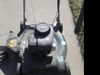 Like new Bolans lawn mower for sale. Mower has a Briggs