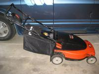 For sale is this Black and Decker electric lawn mower.