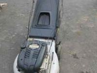 for sale is a Ryobi lawn mower runs great, 6.5 briggs