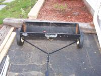 THIS IS A CRAFTMAN LAWN SPREADER PULL WITH TRACTOR SOME