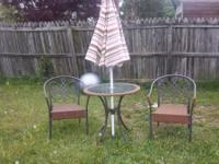 Selling a perfect shape table with chairs. the table