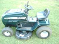 up for sale is a good running lawn tractor cuts good