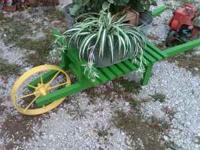 This is an attractive lawn wheelbarrow. The wheel is