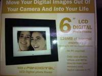 "Selling a brand new in box 6"" digital picture frame."