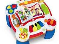The Leapfrog Learn & Groove Musical Table keeps baby
