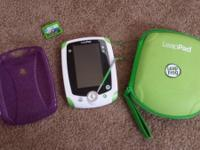 Green LeapPad Explorer with purple gel case and lugging