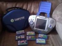 LEAPSTER W/ CASE AND 7 GAMES $65.00 STEP 2 TABLE AND 2