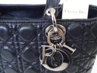 This Chic Christian Dior Black Leather bag clean in and