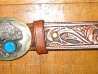 BELT with dramatic silver metal buckle. Genuine leather