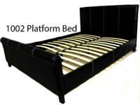 Leather black Platform bed w slates. Go to website or