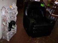 Selling is a leather rocker recliner that is black in