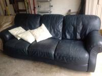 Dark blue leather couch for sale for $100.  Can deliver