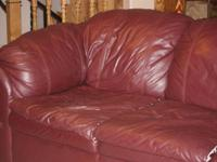Leather couch, maroon.  Comfortable and in fair