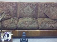 Leather and upholstered couch that was barely used.