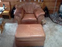 Very nice leather couch, chair, and matching ottoman.