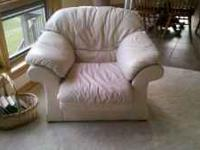Beige leather couch, loveseat, chair and ottoman