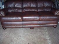 The couch is made of real top grain leather not bonded