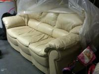 We are selling a two piece beige Italian leather couch