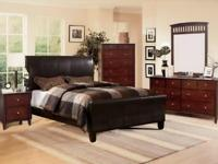 All wood bedroom set with a leather sleigh bed.