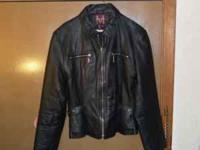 Waist length leather jacket with lining. Very good