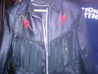 women's black leather jacket with red roses and fringe.