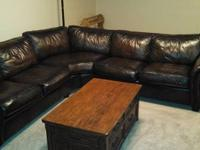 Leather L-shaped couch. Bought new 4 years ago at