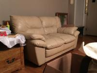 Light tan/beige leather love seat and matching chair.