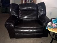 Its a dark brown leather live seat/ recliner. Reclines