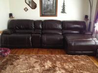 18 month old leather sectional sofa for sale $700 OBO.