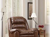 BARELY USED ASHLEY LEATHER MATCH RECLINER. DELIVERY