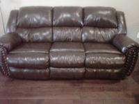 We have 1 leather couch, recliners on both ends $300.00