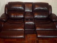 Raymour and Flanigan leather Loveseat fully reclines to