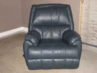 Navy blue rocker/recliner. Asking $75. Call -
