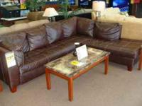 Used brown leather sectional with chaise by Albany