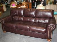JIMMY'S WAREHOUSE has an Ashley leather sleeper sofa in