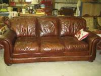 The cushions are very firm and deep. There is nailhead