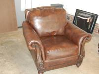 Leather couch and chair for sale. Purchased new in