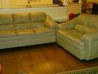 Leather sofa and matching loveseat. Light tan in color,