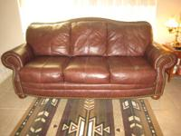 Leather Sofa - Brown.  Small area on one of the arms