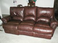 Leather reclining sofa and matching reclining chair,