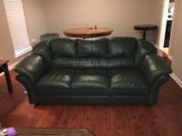 Comfortable leather sofa in fair condition. Color is