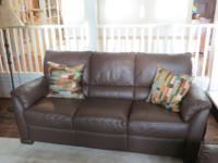 Beautiful leather sofa, like new condition. We moved