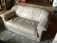 Up for sale is a Taupe color Natuzzi leather sofa /
