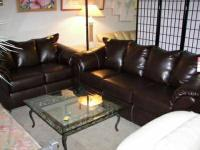 Full sized leather Sofa and Loveseat set. $825.00 OBO