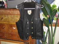 HERE I HAVE A THICK QUALITY MADE LEATHER VEST,HAS